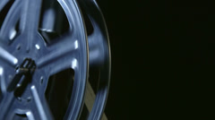 Spinning film reel of movie projector closeup - stock footage