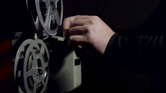 Projectionist operates a movie projector Stock Footage