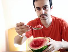 man with watermelon - stock photo