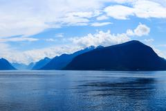 Mountains and fjord in the late afternoon Stock Photos