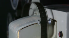 Strip of 16 mm film in movie projector Stock Footage