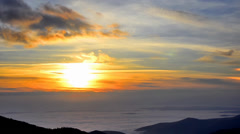 Timelapse sunset in the mountains range mist, fog moving fast Stock Footage
