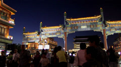 The visitors take photos at the tradition architecture in Qianmen Avenue Stock Footage