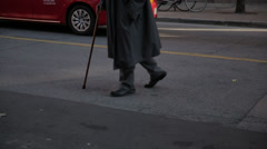 Person walking with a cane Stock Footage