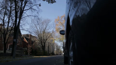 Mini Cooper driving down the street Stock Footage