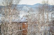 Stock Photo of Winter holiday house in snowy mountains
