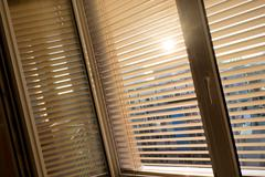 venetian blinds for shade at the window - stock photo