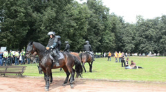 Event patrolled armored police horses forces ensure security Stock Footage