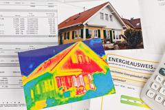 save energy. house with thermal imaging camera - stock photo