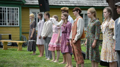 Young people actors stand in row and perform retro show Stock Footage