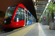 Stock Photo of red and blue tramway stopped at train station