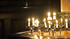 Church candles in the dark close up - stock video Stock Footage