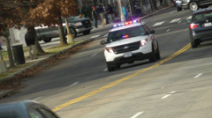 Police car approach; races into distance Stock Footage