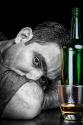 Monochrome image of a drunk and depressed man Stock Photos