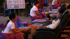 Chiang Mai street foot massage, evening. HD 1080p. - stock footage