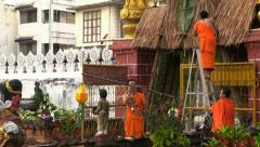Monks decorate the temple with lanterns, Loy Krathong preparation, Chiang Mai. - stock footage