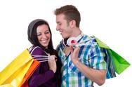 Stock Photo of young couple having fun while shopping