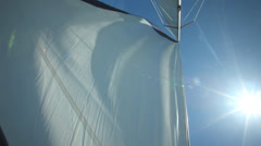 Sail floating in the wind on a beautiful sailboat Stock Footage