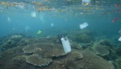 Plastic bags and other garbage floating underwater - stock footage