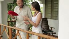 Young angry man reject gift from his girlfriend on house porch HD Stock Footage