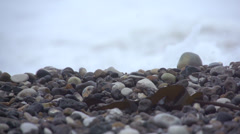 Stones dancing in white water Stock Footage
