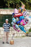 Man sells helium balloons Stock Photos
