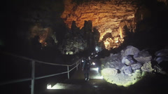 Caver explore grotto - stock footage