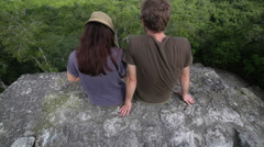 Couple seated on top of temple - stock footage