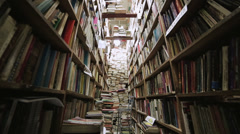 Mountain of books in library Stock Footage