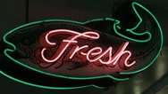 Stock Video Footage of fresh fish neon sign, Pike Place Market, Seattle