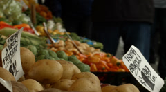 Potatoes, carrots, broccoli, vegetable stand, Farmer's Market, Pike Place Market Stock Footage