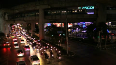 Stock Video Footage of Bangkok evening traffic near MBK and Tokyu shopping Centres. HD 1080p.