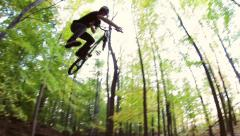 Extreme BMX Bicycle Rider Jumping through Dirt Trails Stock Footage