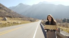 Teenage Girl Holding An Adventure Sign, Realizes It's Upside Down Stock Footage
