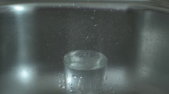 Water Dripping In The Glass Stock Footage