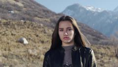Outdoor Portrait of A Teenage Girl Not Smiling Stock Footage