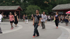 Chinese people dancing at music in people's park in Chengdu Stock Footage