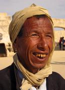 tunisia man by star wars movie set in the sahara desert at ong el jemel tunis - stock photo