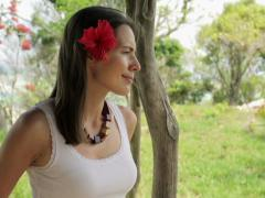 Portrait of young beautiful woman with flower in her hair NTSC Stock Footage