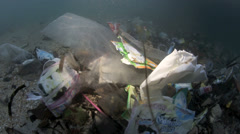 Plastic garbage and other trash underwater Bunaken Island Stock Footage
