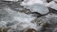 Stock Video Footage of Transparent pure water flows among ice and rock