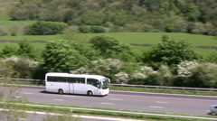 White coach on the M6 motorway Cumbria Stock Footage
