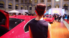 Back of woman standing near Volvo car in Gostiny Dvor Stock Footage