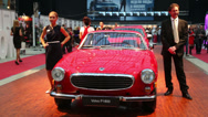 Stock Video Footage of Legendary Volvo P1800 car in Gostiny Dvor