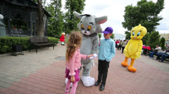 Children with large cat and chicken at III Moscow Festival Stock Footage