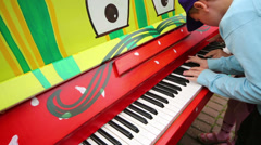 Boy playing at piano at III Moscow Festival Stock Footage