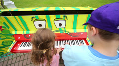 Boy and girl playing at piano at III Moscow Festival Stock Footage