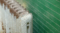 Old antique steam radiator hotel neglected rusty Stock Footage