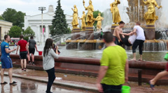 Two boys throwing a girl in water during the day at VVC Stock Footage