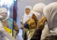 Women praying and walking around in mevlana museum konya turkey Stock Photos